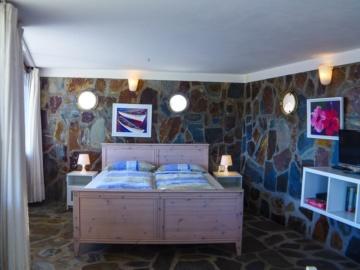Hübsches Schlafzimmer im Bungalow Das Schiff in La Playa